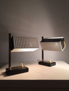 A cute set of 50s Mathieu Mategot bedside table lamps by Deerstedt