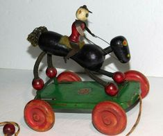 It is a wooden and wood beaded, black race horse and jockey. The jockey has cutout tin arms and legs. The base platform is also tin. Pull Toy, Wooden Toys, Vintage Antiques, Ted, Horse, Ebay, Wooden Toy Plans, Wood Toys, Woodworking Toys