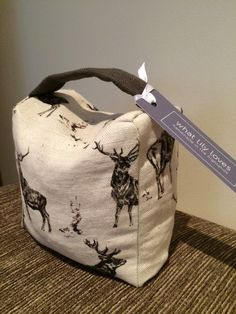Handmade to order - doorstops in fabric of your choice. This item is Milton & Manor Stag Parade Pure Linen fabric £35 plus carriage.