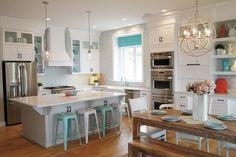Beautiful white/turquoise kitchen. Love the light fixtures and table