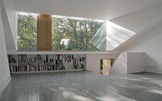 Modern white loft conversion with fully glazed dormer - interior More