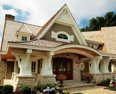 House with character! Craftsman columns; porch; gables and dormers; corbels....all the details.