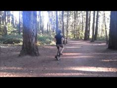 Man plays the accordion on a unicycle while in the woods -- This guy is my hero