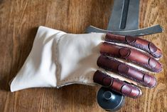 Reconstruction of medieval fencing glove  leather glove made of 2mm calfskin, finger safe 4mm leather boiled in beeswax. Sources medieval miniatures and finger protection from Dordrecht, the Netherlands dated between 1325 and 1400 AD.