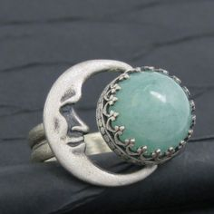 This would have been better with a moon of mother of pearl or moonstone. Crescent moon and jade ring