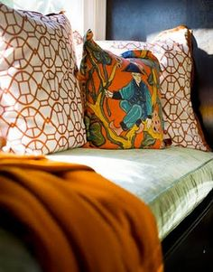 On the velvet-covered daybed in the den, an orange cashmere throw from Hermès and pillows of vintage fabric.