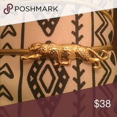 """Vintage 1980s golden jaguar belt Fierce! I've never seen another one of these but I don't wear it enough.  30"""" around without being stretched, clasps behind the 🐱. Accessories Belts"""