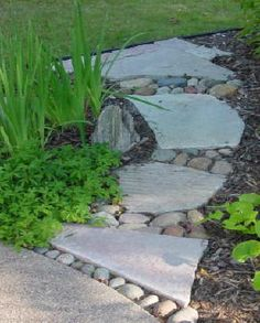Another nice example of mixing flagstone with river rock