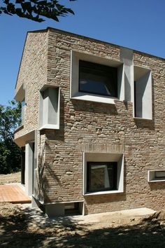 This beautiful rural construction is nestled in the mountains, on uneven terrain. Its walls, built out of aged brick, contrast with the modern glass windows that appear to peek out from them. The mixture of materials is interesting, and fits perfectly with the atmosphere that surrounds the home. Located in Ripatransone, Italy, its reconstruction took a total of four years, starting in 2005 and lasting until 2009, and was carried..