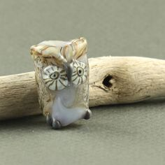 WANTZ!!! Whisper owl dread bead , glow glass owl dread bead, glow in the dark dread bead. $35.00, via Etsy.