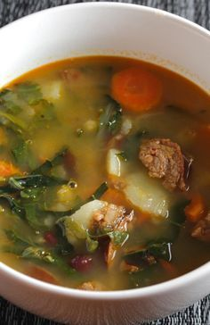 Kale simmers with sausage, garlic, onions and more for the Best Portuguese Kale Soup recipe.