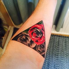 Roses in a triangle tatto on my forearm! One red and coloured, the others shaded! Start to my sleeve tatto!