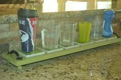 Assign everyone in the family a glass using this coaster trick. | 37 Hacks To Make Dish Washing Easier