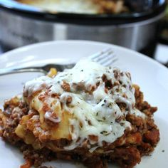 This is our lazy day crock pot lasagna recipe. You are going to love this fun twist on a traditional lasagna with this easy crock pot lasagna recipe.