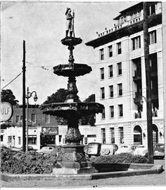 Fountain Square in 1949, in Chattanooga, Tennessee the Hogshead Apartments on the right. The fountain was dedicated to Henry Iler and William M. Peak who died in the Bee Hive fire in 1886