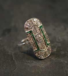 Love this Vintage Wedding Ring. The green stones add a bit of Indian Flair!