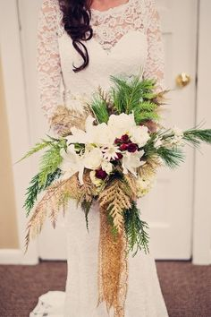 Winter wedding bouquet idea - roses, lilies, pine needles, evergreen + gold sparkly ribbon {Marianne Wiest Photography}