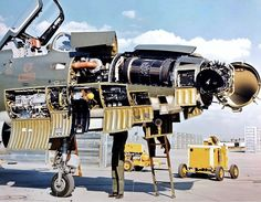 A Republic F-105 Thunderchief with nose panels open up for maintenance.