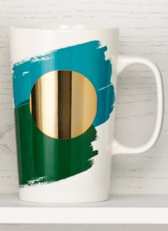 Ceramic coffee mug with paintbrush stripes and shiny gold dot. #Starbucks #DotCollection