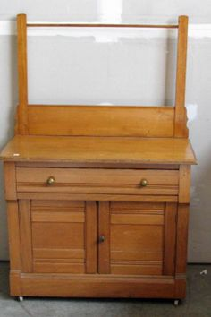 """$135.00.Oak Washstand with Towel Bar.  Nicely finished in a golden oak stain is this oak washstand with towel bar, doors and drawer operate very easy and is ready for use in your home, measurements are 34"""" Wide X 16"""" Deep X 28"""" High and 51"""" High at towel bar.  Please email city and zip for shipping cost"""