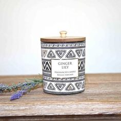 With a natural wooden lid this Ginger Lily candle smells amazing. An Aztec design ensures it will look stylish in any home. #candle #candlepoy #candlelight #candles #scentedcandles #candlegift Home Interior Accessories, Aztec Designs, Elegant Homes, Rustic Furniture, Scented Candles, Flask, Your Design, Compliments, Lily