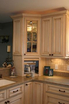 """I hate counter clutter. Told hubby in the new kitchen he was going to have an appliance garage for his coffee maker. His reply """"only if I can install a remote opener!"""" LOLOLOL"""