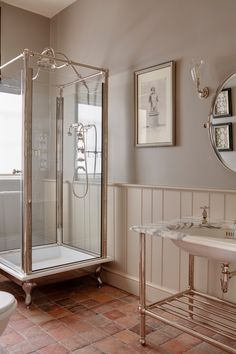 A calm, uncluttered bathroom of neutral tones designed by @studioindigoltd The centrepiece of this charming ensuite bathroom is our Spittal Freestanding Shower with a polished cast iron tray. The Crake vanity with its marble top and polished nickel fittings blurs the margins between traditional and contemporary in the overall scheme. Ph: @lukewhitephotography Standing Shower, Interior Decorating, Interior Design, Interior Ideas, Classic Bathroom, Beautiful Bathrooms, New Room, Victorian Homes, Interior Architecture