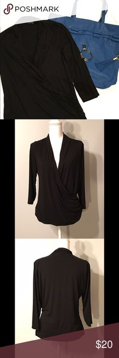 The limited top Black, stretchy, surplice top with quarter length sleeves. Great  condition, only worn once. Size XL. 95% rayon, 5% spandex. The Limited Tops Blouses