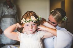 Flower girl wears a peach rose flower crown | Photography by http://photography34.co.uk/