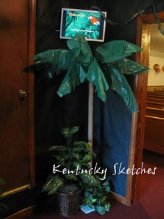 DIY Palm Tree with PVC pipe, green plastic table cloth and floral wire