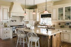 25 Home Plans with Dream Kitchen Designs Cottage House Plan 2369 - The Campbell | A beautifully modern take on a French country inspired kitchen.
