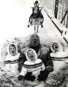 Alfred Hitchcock taking a ride with his grandkids.