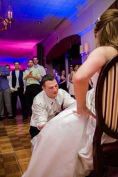 Get the garter shot from the groom's perspective.  Gina and Matt's love shone like the brightest beacon in New England during their wedding at the Downtown Harvard Club » Fucci's Photos of Boston–Something Blue Blog | Boston Wedding Photographer