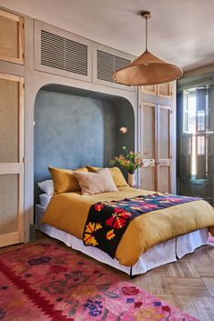 In place of a headboard, this bedroom design is tucked into a an alcove and surrounded by storage cabinets. Storage Cabinets, Storage Shelves, Rug Over Carpet, Rug Ideas, Hotel Interiors, Cabinet Makeover, Cool Rugs, Lighting Ideas, Rugs In Living Room
