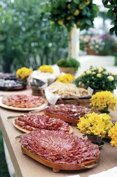 Charcuterie arranged on wooden dishes compliment the natural feel of this wedding reception decor.