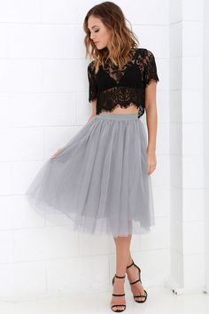 You never know what romance could be around the next corner, so be prepared with the Urban Fairy Tale Grey Tulle Skirt! A playful silhouette begins with a soft elastic waistband from which voluminous layers of tulle fall to a midi-length hem.