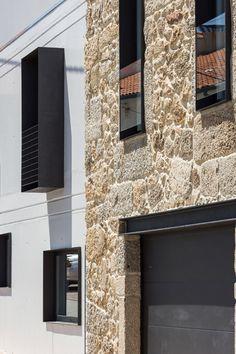 Filipe Pina + Ines Costa // House JA ; that's a balcony, neat massice black iron sheets