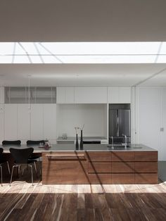 Frame is a minimalist house located in Hiroshima, Japan, designed by UID Architects.