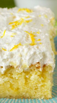 Drenched Lemon Cream Cake ~ This lemon cake is a super simple mini sheet cake (it's in and out of the oven in 20 minutes flat) drenched in lemon syrup and topped with fluffy whipped cream.
