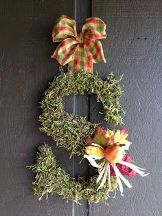 Mossy Floral Fall Monogram Door Decor...this would be great to decorate for Halloween or any holiday theme...Kim: This Ole Mom.  Instructions included.