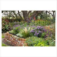 brick raised garden beds. . .