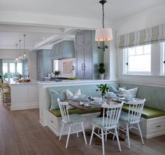Built in banquette. Open kitchen with built in banquette. L shaped built in banquette in breakfast room. #builtinbanquette Kim Grant Design Inc.