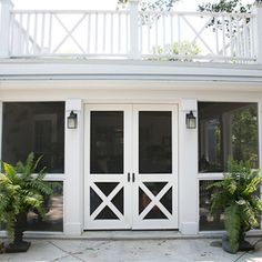 LOVE these double screen doors for sun porch area