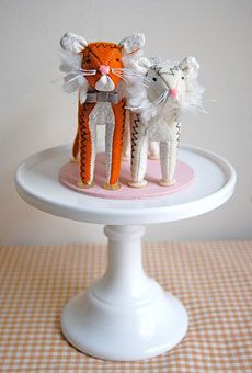 UNIQUE WEDDING CAKE TOPPERS  Felt tiger cake topper, $150, Sian Keegan