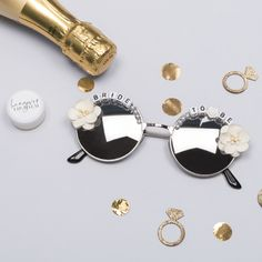 These bride sunglasses are the coolest accessory for your bride this summer. For the gal who was born to standout, white round frame sunglasses.
