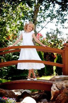 adorable girl in white in the bridge