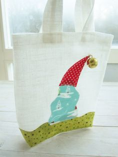 Linen white Christmas gift bag decorated with by poppyshome, $16.00