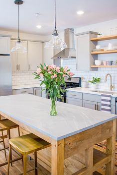 Farmhouse kitchen trends with timeless appeal for include mixed materials, industrial touches, apron-front sinks, Shaker cabinets, shiplap, Cambria natural stone countertops, warm woods, and inviting neutrals. Gather farmhouse kitchen ideas and inspiration from some of these perfect pairings and final looks. #FarmhouseKitchenIdeas #KitchenIdeas