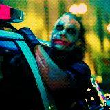 The Joker outside cop car window