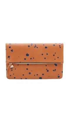 Clare V. Margot Fold Over Clutch, cuoio navy (tan brown blue paint splattor) $235, sale $164.50 | Shopbop